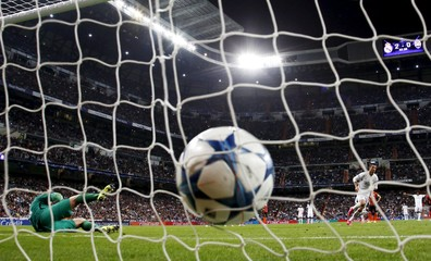Real Madrid's Ronaldo scores during their Champions League soccer match against Shakhtar Donetsk at Santiago Bernabeu stadium in Madrid