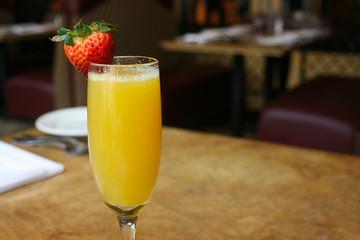 Single mimosa cocktail glass, horizontal