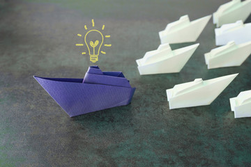 Origami paper ships, change, innovation business concept