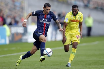 Paris St Germain's Di Maria challenges FC Nantes' Moimbe during their French Ligue 1 soccer match at the Beaujoire stadium in Nantes