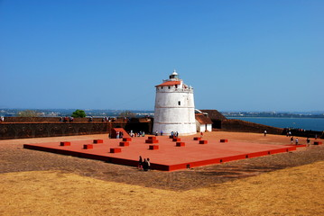 The lighthouse of the Aguada Fort in Candolim, Goa, India overlooking the Arabian Sea