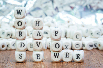 Wood dice with WORDS HAVE POWER