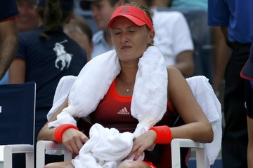 Mladenovic of France his with an ice-filled towel on her shoulders as she tries to cool off between games during her quarterfinals match against Vinci of Italy at the U.S. Open Championships tennis tournament in New York