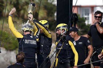 Skipper Nathan Outteridge is doused with champagne by the crew of Artemis Racing aboard their AC45F racing sailboat after winning the America's Cup World Series sailing competition on the Great Sound in Hamilton