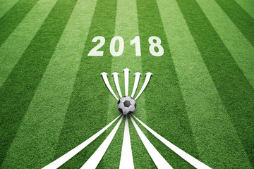 Conceptual soccer play abstract strategy planning with soccer ball, arrows and year 2018. Soccer game copy space background.