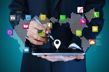 man using digital tablet with social media icon