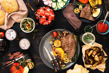 Meat and vegetables grill with wine and beer