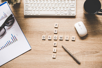 Words of business concepts collected in crossword with wooden cubes. Concept business.