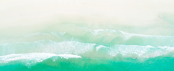 Aerial drone shot of turquoise sea water at the beach