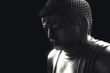 asian buddha on black for background with copy space.