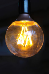 Glowing vintage light bulb