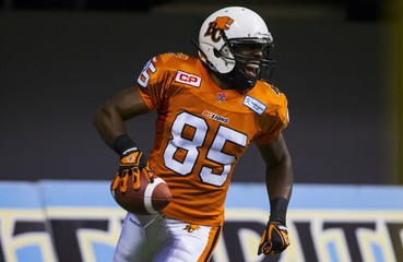 B.C Lions' Shawn Gore celebrates his touchdown against the Hamilton Tiger-Cats during their CFL football game in Vancouver