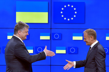 European Council President Tusk shakes hand with Ukrainian President Poroshenko after a joint news conference in Brussels