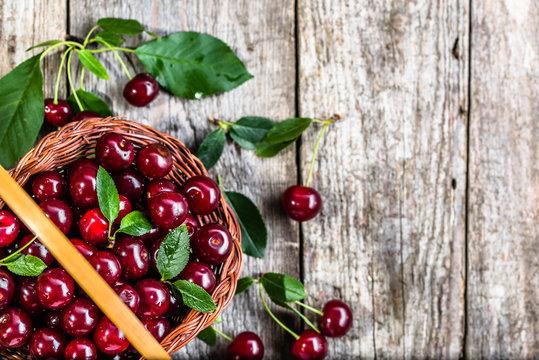 Organic cherries, farm fresh fruits on farmer table