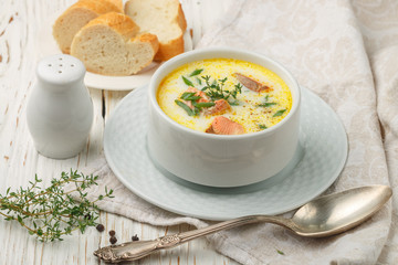 Delicious cream soup with fresh salmon with vegetables and spices. Lunch gourmet
