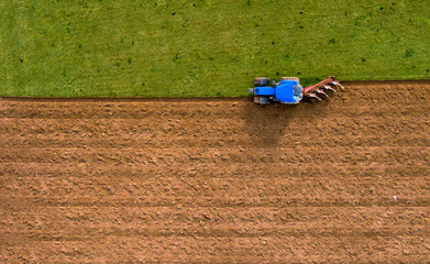 Tractor Ploughing Plowing Field - Aerial Shot