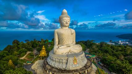 aerial photography white great Phuket's big Buddha in blue sky.