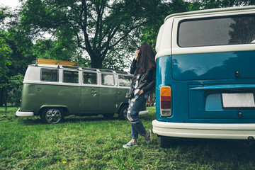 stylish woman stand near retro van
