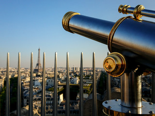 Monocular telescope and panoramic views of Paris in a sunny day with Eiffel Tower