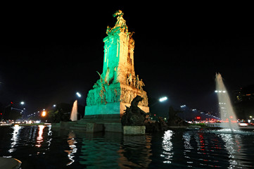 The Monumento a Los Espanoles (Monument to Spanish) is seen lit in the colours of Brazil's flag in homage to 2016 Rio Olympics in Buenos Aires