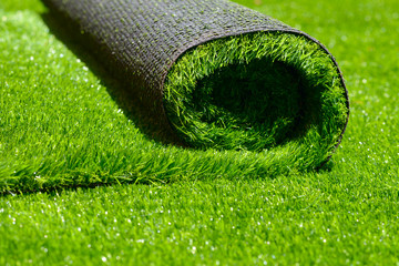 Tuinposter Gras artificial rolled green grass
