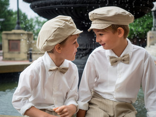 Little boys dressed up in town