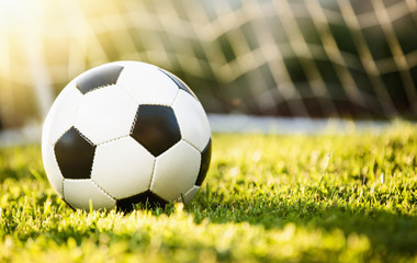 Closeup soccer ball on green grass