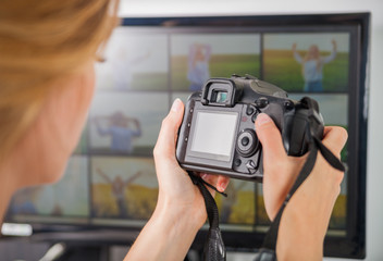 Freelance photographer woman at home office editing photos, blank camera screen