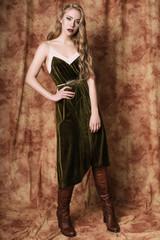 Beautiful fashion model in a velvet green dress. Vintage. Luxury style.