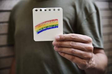 man with a rainbow flag