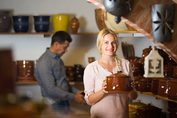 Female customer in ceramics workshop.