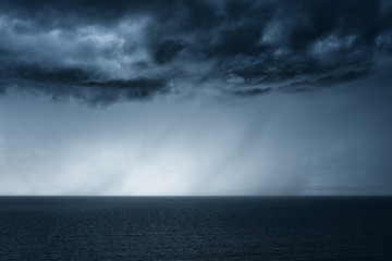 rain on the sea with stormy clouds