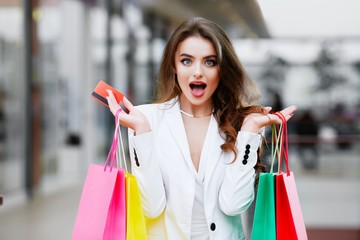 Surprised woman purchasing by credit card