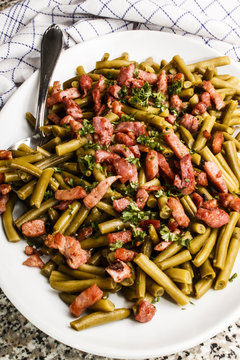 green beans and roasted bacon bits on a plate