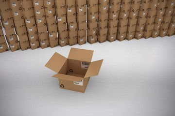Composite image of empty cardboard box by stack of boxes