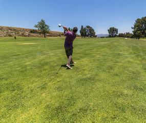 Young male playing golf