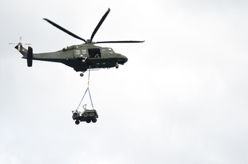Garden Poster Helicopter Green Military Helicopter Carrying a Jeep