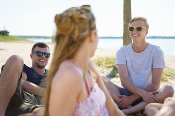 Group of university friends relaxing on a beach