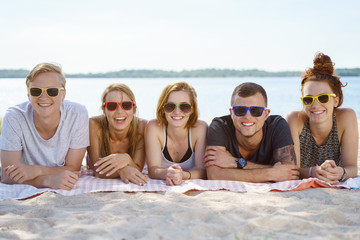Group of young friends enjoying a day at the beach