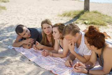 Group of young people relaxing on the beach