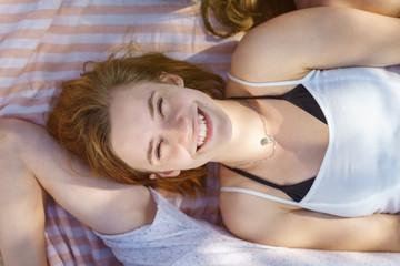 Pretty woman lying on a towel enjoying the sunshine
