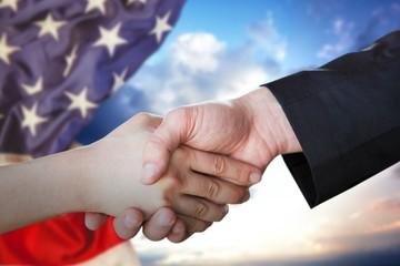 Composite image of people doing handshake