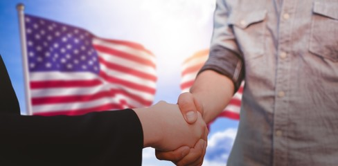 Composite image of corporate man and woman shaking hands