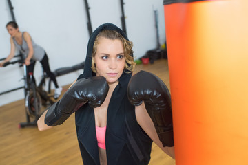 beautiful woman ready to fight at gym