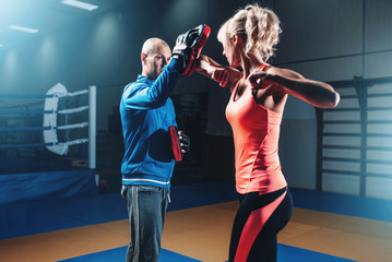 Woman on self defense training with male trainer