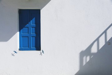 Blue Closed Window On Wall Of House