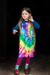 Portrait of young girl wearing tie dye dress
