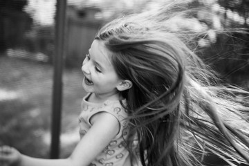 Girl with long hair, laughing