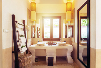 Interior of bathroom with washbasin faucet and white towels. Modern bathroom  design