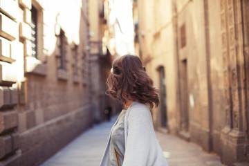 Female traveler walking in European old city streets